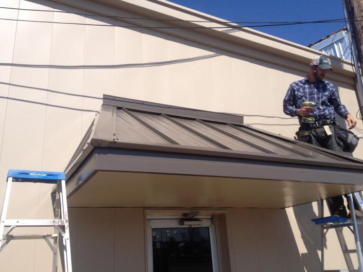[Image: Metal awning. Wall resurfacing. Downtown Paragould. Color options available ]